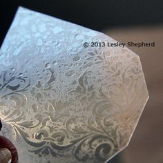 Recycled packaging plastic embossed to make faux 'etched' glass for miniatures and models. - Photo © 2013 Lesley Shepherd