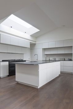 AuBergewohnlich Modern Kitchen / Minimalism / Wood Floors / White Units / Rooflight /  Archer + Braun