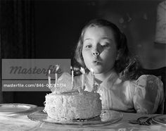 1950s MAKE A WISHS  - BLOWING OUT BIRTHDAY CAKE CANDLESImage © ClassicStock / Masterfile.com: Creative Stock Photos, Vectors and Illustrations for Web, Mobile and Print
