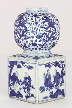 RARE BLUE AND WHITE DOUBLE-GOURD VASE JIAJING SIX-CHARACTER MARK WITHIN A DOUBLE SQUARE AND OF THE PERIOD (1522-1566) Potted with a globular upper bulb and square lower section, painted in cobalt blue with ruyi band about the neck, dragons on the upper bulb, a classic scroll encircling the waist, on the lower square section sages and immortals in landscape, the base unglazed except for the recessed square which contains the mark. 12¾ in. (32 cm.) high