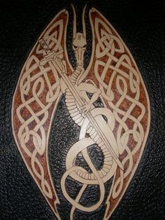 celtic_dragon_with_sword_by_tradarcher-d4dl47d.jpg 774×1,032 pixels