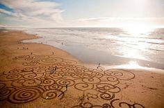 FOTOSPECIAL. Schilderijen in het zand (8) - Het Nieuwsblad