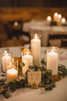A romantic table setting with different sized candles. This could easily be created with flameless candles too.