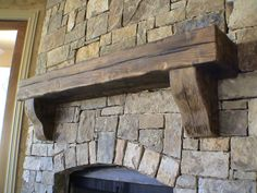 Rustic mantel on stack stone