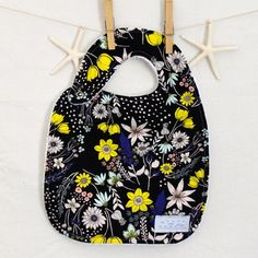 Black Floral Bib.  Amazing, absorbant and soft terry cloth backing, and so many patterns!