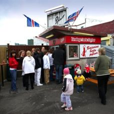 "Bæjarins beztu is a popular hot dog stand in central Reykjavík, Iceland which has been operating since 1937. In August 2006, the British newspaper The Guardian selected this humble and unassuming little kiosk as the best hot dog stand in Europe. The hot dogs are primarily made of lamb and have an incomparable savory smokiness complimented by the snap of their natural casing. Order ""eina með öllu""- divine!"