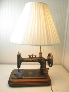Very unique sewing machine table lamp. New Home sewing machine made in Orange Mass. This is a real sewing machine, made into a lamp. They did a very nice job and works great! The shade is negotiable, it will come with the lamp but will have to be shipped Sewing Machine Tables, Antique Sewing Machines, Sewing Tables, Repurposed Furniture, Diy Furniture, Vintage Furniture, Diy Home Decor, Room Decor, Decor Crafts