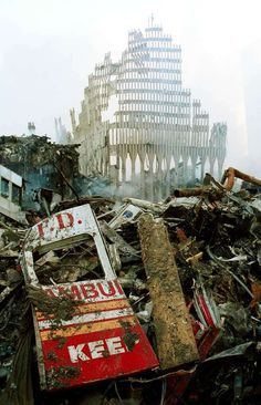 NEW YORK - SEPTEMBER 13, 2001:  Remnants of a New York City Fire Department vehicle lie in the wreckage of the World Trade Center, two days after the twin towers were destroyed after being hit by two hijacked passenger jets, September 13, 2001 in New  York City. This September 11 marks ten years since members of Al Qaeda hijacked four planes, attacking the World Trade Center and the Pentagon and crashing one in Shanksville, Pennsylvania, killing nearly 3,000 people in all. The effects…