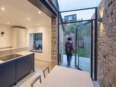 Nice way of connecting the garden with the inside without having large doors across the whole wall. The designer has used a floating window seat sticking out into the garden to create the feeling of being inside and out.