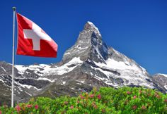 Photo about Beautiful mountain Matterhorn with Swiss flag - Swiss Alps. Image of scenery, swiss, rocky - 17415395 Zermatt, Swiss Flag, Eastern Countries, St Moritz, Seen, Hotel Reservations, Alps, Beautiful Places, Scenery