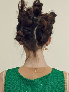 Angels models a hairstyle featuring several messy, mini buns