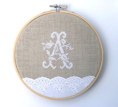 Embroidery hoop art. Hand embroidered initial A. Made of highest quality linen, white cotton lace and embroidered with highest quality stranded