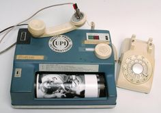 Want to send a photo by telephone in the 1970s? You're looking at the United Press International UPI Model 16-S photo transmitter. The photo would spin in the drum and one line at a time would be sent. Typically it'd take 26 minutes for one photo!