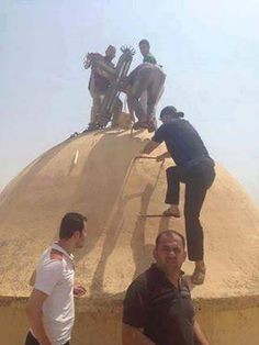 In Tel Esqof, Nineveh The cross of this church is being put back on :-) More to come.... #Iraq