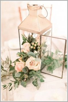 33 Best Floral Wedding Centerpieces Ever! - Amaze Paperie 33 Best Floral Wedding Centerpieces Ever! Lantern Centerpiece Wedding, Simple Wedding Centerpieces, Floral Centerpieces, Centerpiece Ideas, Flower Table Decorations, Table Decorations For Weddings, Diy Wedding Lanterns, Rose Gold Centerpiece, Vintage Table Decorations