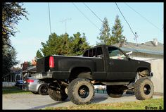 black lifted Chevrolet Silverado truck