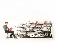 """Chilean artist Sebastian Errazuriz  latest artwork was made from a tree branch he simply found on a Santiago City street. He took it back to his studio, painted and polished it, then put in panes of glass. The result is a one-of-a-kind shelf that's organic, minimal, and striking.  'It's important to me that a project consist of just a little twist', Errazuriz explains, """"because I ultimately want people to see the obvious, the everyday differently'."""
