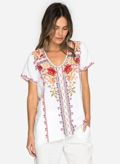 89bf75e80946 Description  The LIBBIE DRAPE TOP is a custom embroidered linen blouse with  luxurious embroidery details of lush flowers and leaves that cascade down  the ...