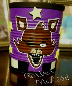 Five Nights at Freddy's Foxy fan art made from baby formula can and paint markers DIY   I used a baby formula can, paint markers, yellow foam stickers, & Chalkboard paint (for the lid so you can label your storage container).