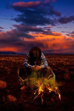 Lone cowboy sunset outdoors nature clouds fire desert country alone camping cowboy praying