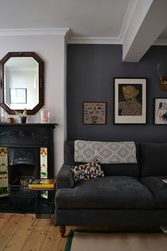 Name: Sue Huey & Graeme Fraser Location: Brighton, East Sussex, UK Years lived in: 4 years; Owned Located in the very heart of central Brighton, Sue and Graeme's Victorian townhouse is a refuge of tranquility, just yards from the city's main shopping stre Living Room Grey, Home And Living, Blue Feature Wall Living Room, Charcoal Sofa Living Room, Dark Grey Feature Wall, Colour Schemes For Living Room, Living Room Accent Wall, Navy Blue And Grey Living Room, Painted Feature Wall