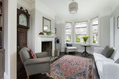Living room - dark floors with pale grey walls