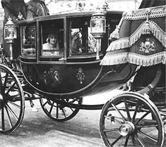 Lady Elizabeth Bowes-Lyon travels by carriage to Westminister Abbey for her wedding to the Duke of Yoke, later King George VI, April 26, 1923