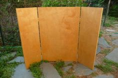 Plywood trifold sign. decorate with decal lettering and also cut whole for frame. DIY photobooth