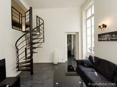 Check out this uniquely designed and modernized 1 bedroom apartment in Bourse, Paris! Coated with white walls and grey/black furniture, this loft is furnished with multiple shelves, elongated windows to pour in that morning sunshine, walk-in closets for extra space & a fully furnished, colorful kitchen to making cooking a delight! You will also have a great views over your Parisian neighborhood :-)