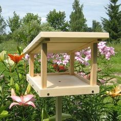 Wood Bird Feeder, 25 Design Ideas for DIY Garden Decorations Wood birdfeeders are functional and attractive Wood Bird Feeder, Bird Feeder Plans, Bird House Feeder, Rustic Bird Feeders, Modern Bird Feeders, Homemade Bird Houses, Homemade Bird Feeders, Bird Houses Diy, Building Bird Houses