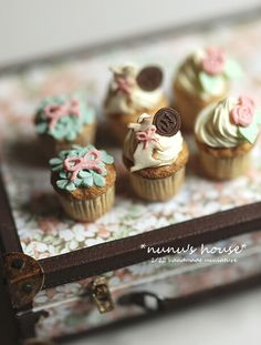 1:12 scale miniature iced cupcakes with monogram chocolate decorations. This miniature artist, Tomo Tanaka of Nunu's House, is the best of the best.