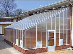 The Evangeline Lean-To Greenhouses are available with many options. It comes with a choice of clear twinwall or 5 wall polycarbonate. Have a ranch style home? We can lower the roof pitch so you can attach this greenhouse to your one story home. Greenhouse Attached To House, Lean To Greenhouse, Greenhouse Gardening, Greenhouse Ideas, Traditional Greenhouses, Commercial Greenhouse, Outdoor Plants, Outdoor Decor, Conservatory Garden