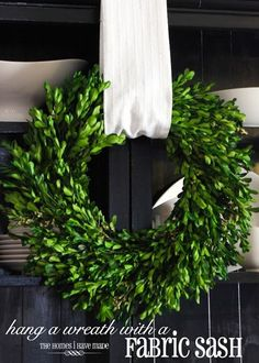 I promised then that I would show you the nifty way I hung my boxwood wreath on the front of the bookcases, and I am here today to fulfill that promise! Let me show you how to hang a wreath with fabric!