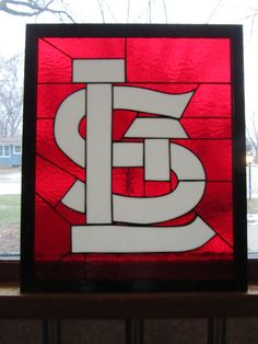 Go Cards! This beautiful panel measures 21.5 X 18. It has a black wood frame that enhances the Cardinal red textured glass. Please allow 2 days