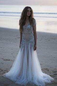 Beach Wedding Dress / Pushing Back The Dawn Editorial by The LANE (instagram: the_lane) http://thelane.com