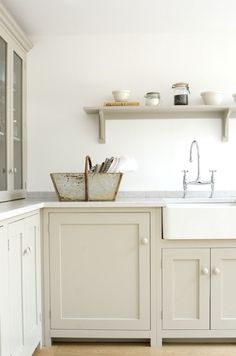 Cabinets are painted in deVol's  Mushroom paint; for something similar, consider Spring Thaw from Benjamin Moore or Elephant's Breath from Farrow & Ball.