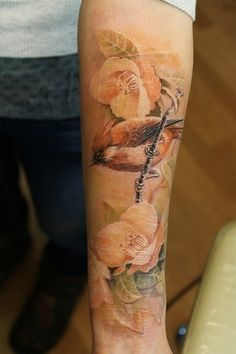 forearm tattoo of birds and flowers again with the delicate style of no outline
