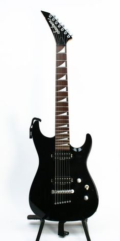 Jackson DR7 7-String electric guitar. The color is Black. It has a string thru body bridge, matte silver finish hardware, Duncan designed pickups. A discontinued but incredibly well built 7 string electric.  Very low action and fluid playability.  A couple of minor dings but nothing bad.   The original List price of this guitar was $895.00.  This comes with a thickly padded Tourist Grade Artist Series gig bag.  The guitar itself has a locking strap installed.
