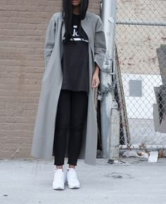 grey trencie, black shirt white logo, white trainers