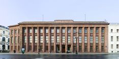 The German Imperial Embassy (designed 1911-12) on St. Isaac's Square, Saint Petersburg, is considered the key template for Stripped Classicism.