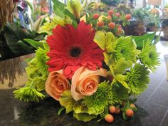 Handheld bouquet in bold vibrant tones