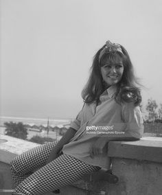 italian-actress-claudia-cardinale-sitting-on-a-balustrade-lido-picture-id138085897 (848×1024)