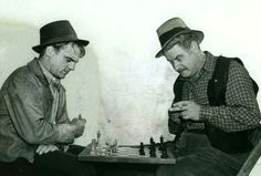 James Cagney and Alan Hale play chess between takes on the set of Captains of the Clouds. August, 1941