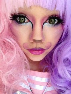 Tempest's perfect Cheshire Cat makeup! Colorful contouring creates the feline shape. Lashes and dramatic eyeliner really widen the eye.