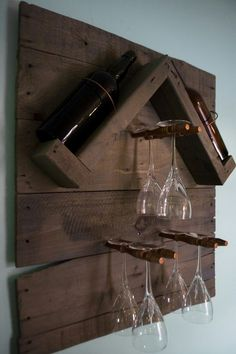 Reclaimed gray washed wood pallet turned into a wine bottle and glass rack with copper accenting