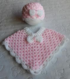 Beautiful hand crochet baby poncho and hat in pink baby twinkle with white trim and bows. Size is newborn
