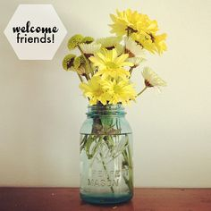 Mixed yellow flowers in a blue Bell jar -- perfect!