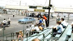 Fans view from starting line stands on east side of strip at Lions.
