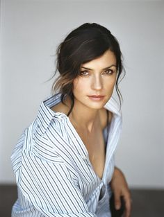 famke janssen - dark brunette with subtle highlights and dipped ends around face