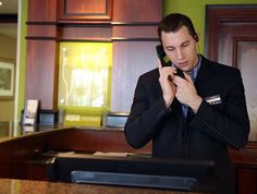 """Hilton Garden Inn guest service representative Cody Artuso, of Hebron, talks about we is most interesting about his job. """"I absolutely love interacting with the guests. Some are from places like California and Florida that have never been here before and want to know what it's like. Others are regular guest and appreciate the friendliness when they travel. I enjoy talking about random things some of our regulars like family and work. It's very fascinating meeting people."""" (Damian Rico)"""